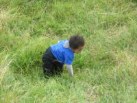 Climbing up the Maunga aged 2